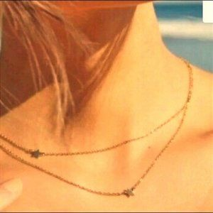 double star yellow gold tone necklace.